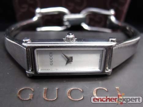 33f54da4dfc Montre gucci 1500 l pour femme en acier argente - Authenticité ...
