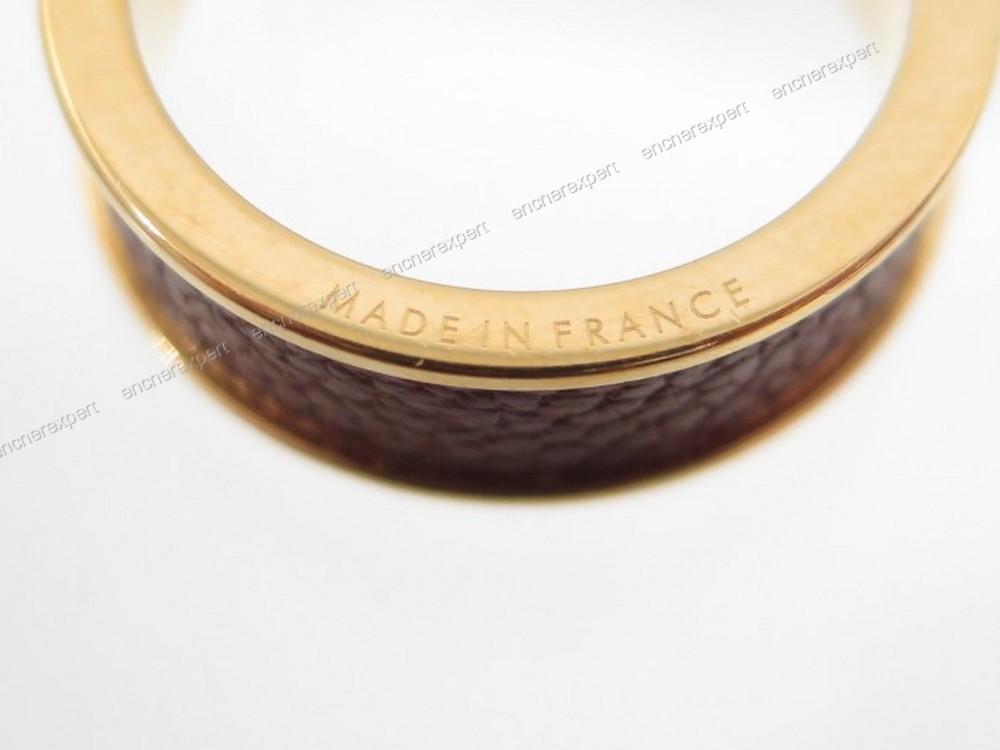 anneau de foulard hermes metal dore et cuir marron authenticit garantie visible en boutique. Black Bedroom Furniture Sets. Home Design Ideas