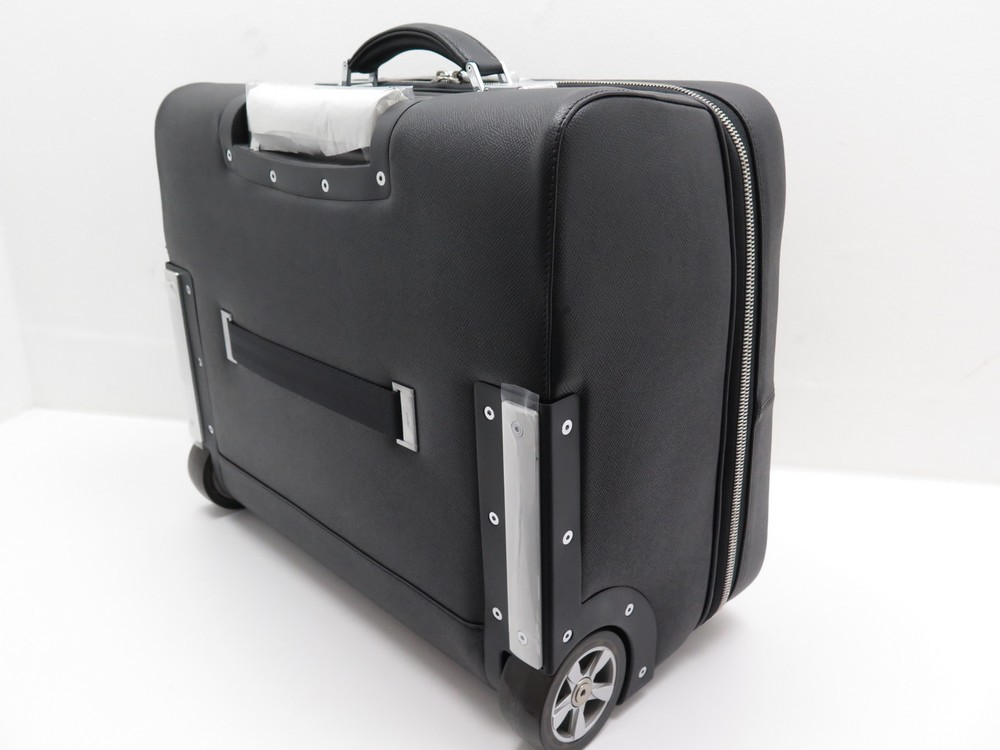 neuf valise a roulette porsche design briefcase s authenticit garantie visible en boutique. Black Bedroom Furniture Sets. Home Design Ideas